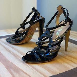 Black and gold strappy leather heels
